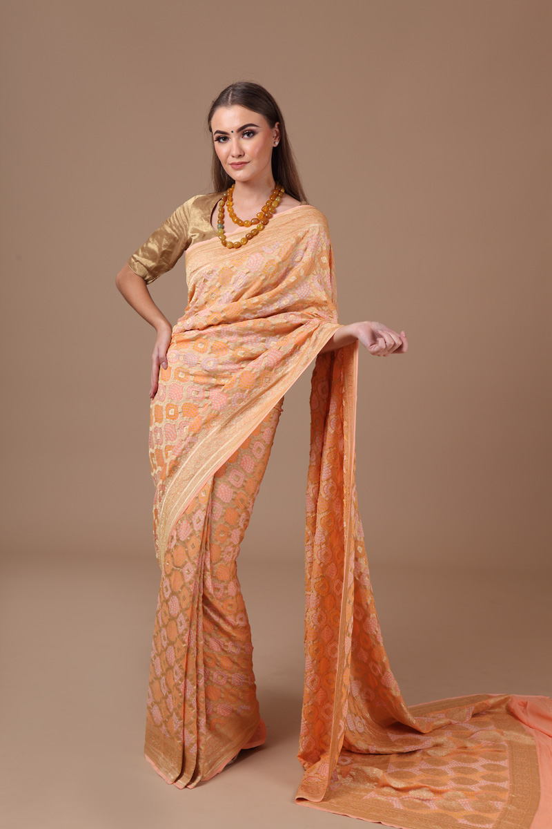 pure-hand-woven-benarasi-georgette-light-peach-bandhej-saree
